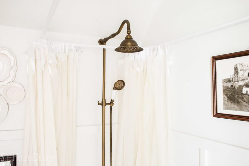 All this was hung with satin ribbon instead of curtain rings. I tried several rings, but they just didn't have that c. 1900s look I was going for. describe shower curtain, again;