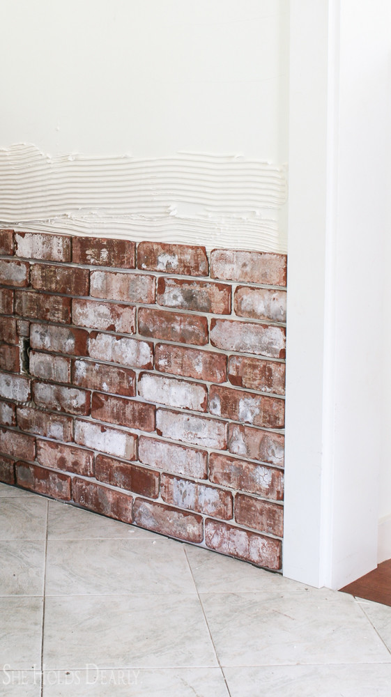 How To Install A Rustic Brick Accent Wall She Holds Dearly