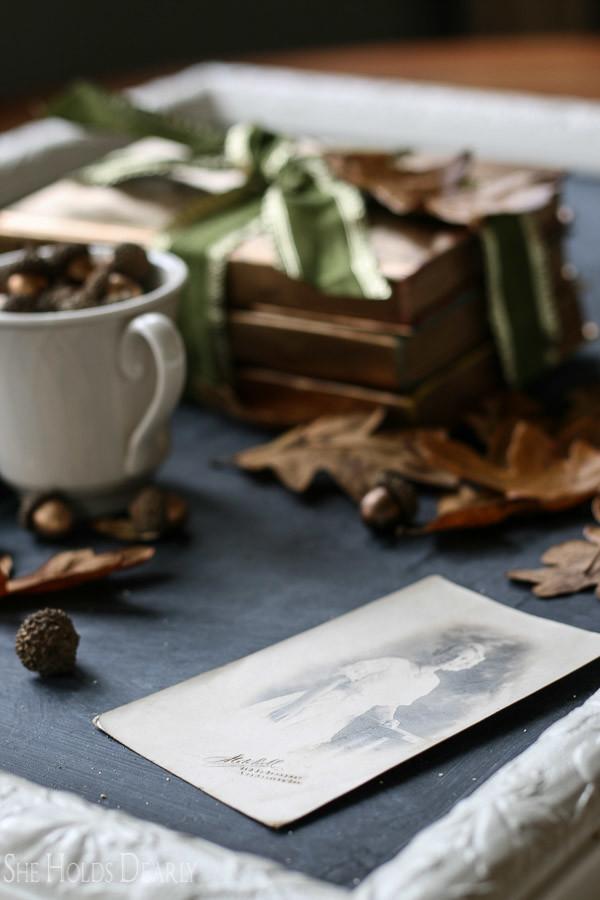 oak leaves, velvet pumpkin, gold acorns and books for fall decor
