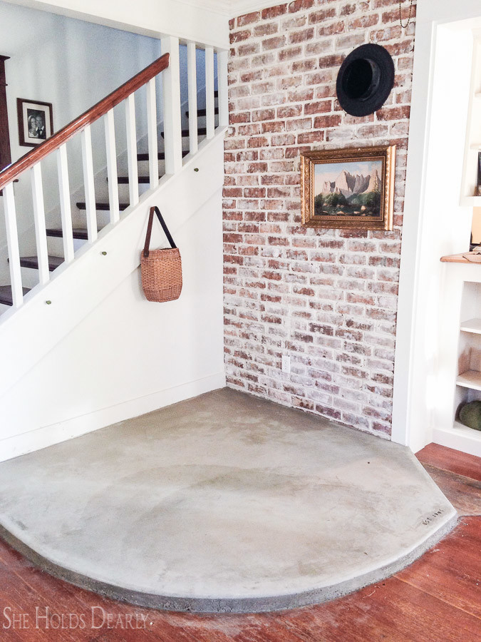 Diy concrete hearth she holds dearly a simple rustic hearth design for a modern farmhouse look solutioingenieria Choice Image