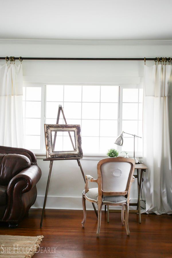 Farmhouse Living Room Before and After by sheholdsdearly.com