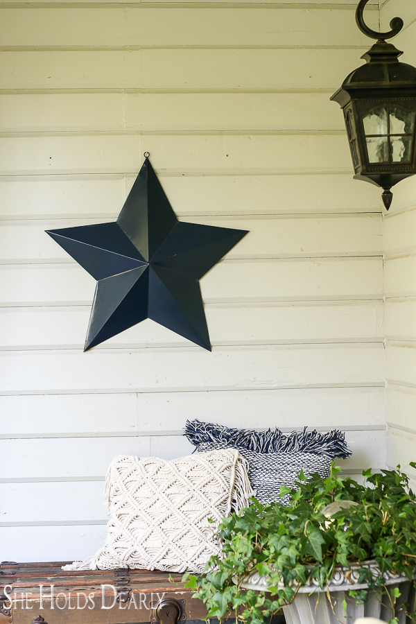 Old steamer trunk and hanging star make perfect farmhouse porch decor for summer
