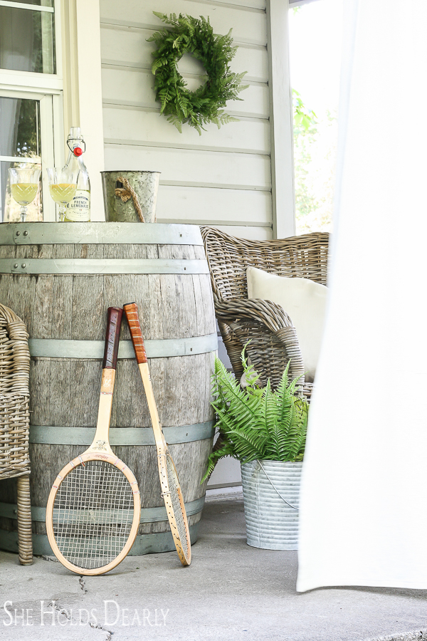 Vintage tennis rackets as porch decor for old farmhouse by sheholdsdearly.com