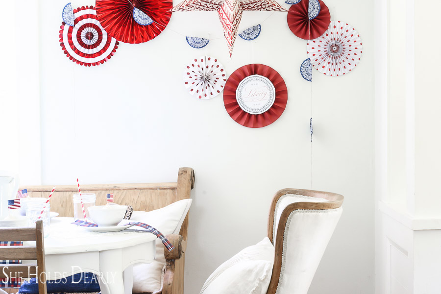 This inexpensive backdrop is perfect for the 4th of July! Check out how to make your own patriotic paper fan wall decor.
