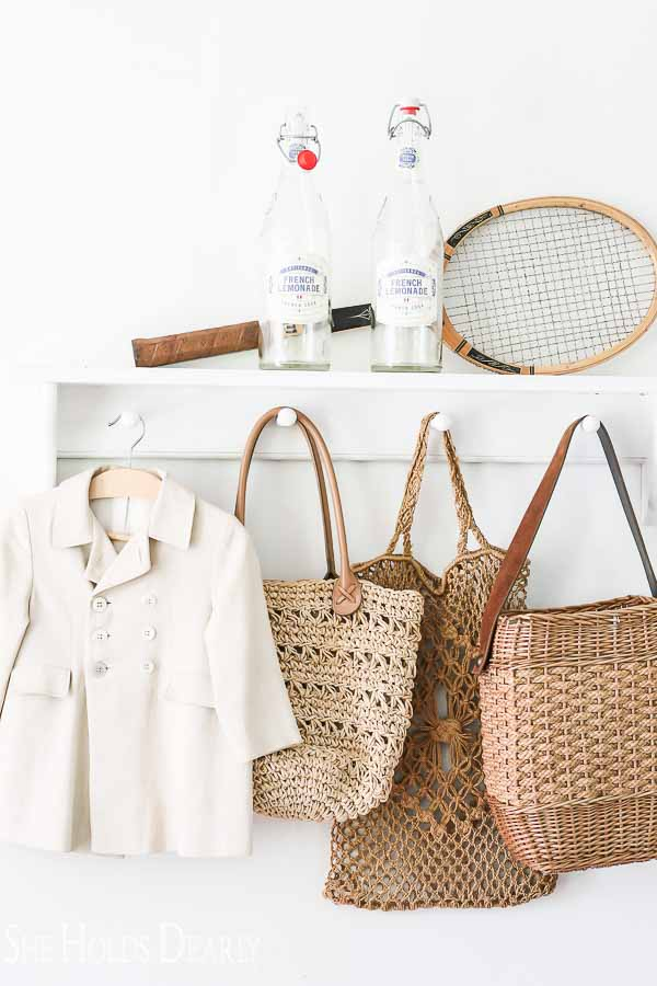 Vintage tennis racket and french lemonade on shelf
