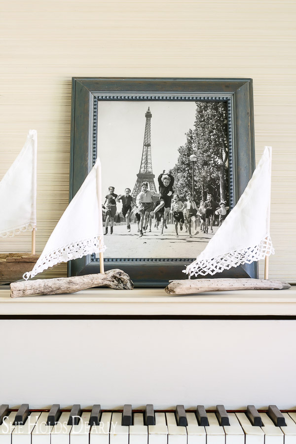 Here is a darling way to use a vintage handkerchief and a piece of driftwood, make your own driftwood sailboat! A perfect gift or centerpiece.