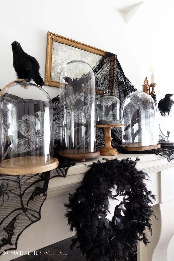 Halloween Mantel Decorating Bats Crows by somuchbetterwithage.com